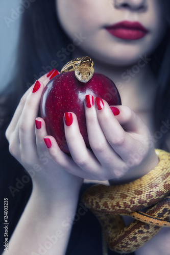 Fotografie, Obraz  Portrait of a young beautiful woman with a snake.