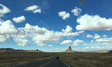 On The Road Towards The Monument Valley, Under Blue Sky