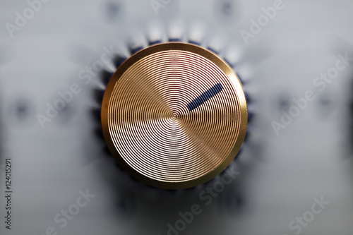 Tela close up of golden knob guitar amplifier