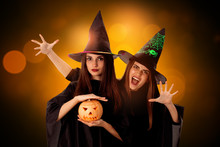 Young Pretty Women With Pumpkins In Hands