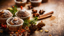 Christmas Chocolate Walnut Muffins Among Christmas Decoration On A Wooden Table