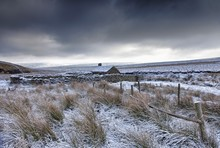 Cloudy Sky Over Snowy Field; Yorkshire Dales, England