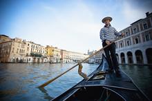 A Gondolier Rowing A Gondola; Venice, Venezia, Italy