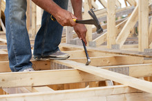 Tradesman Working On Framing For New Home Construction; St. Albert, Alberta, Canada
