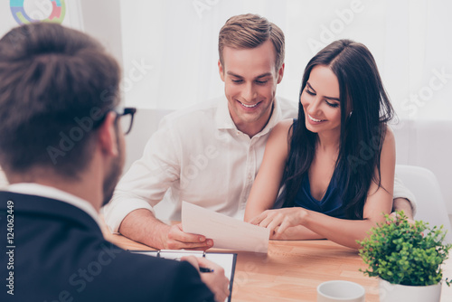 Successful lawyer giving consultation to family couple about buy