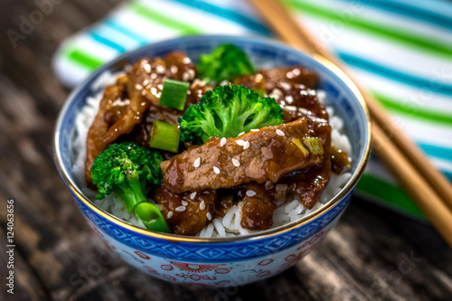 Photo  Beef in sauce with broccoli and rice