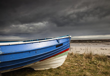 A Colourful Rowboat On The Sho...