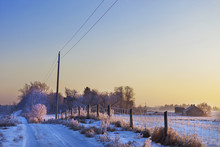 Snow And Frost Cover A Rural Road And Farmland; Parkland County, Alberta, Canada