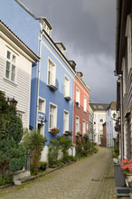 Colourful Houses Along A Street; Bergen, Norway