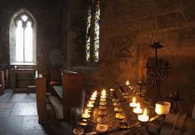 Candles Lit Inside A Church Sa...