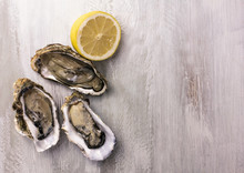 Freshly Shucked Oysters With Lemon And Copyspace