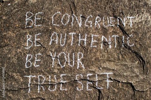 Be congruent be authentic be your true self. Creative motivation concept is written on a stone.