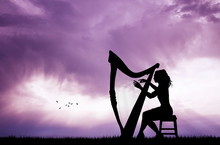 Woman Playing The Harp At Sunset