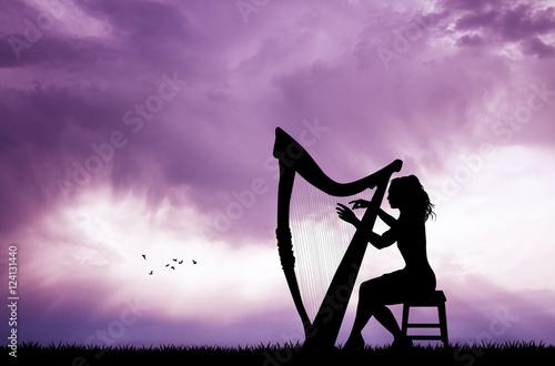 Fényképezés woman playing the harp at sunset