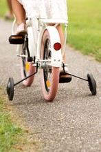 Little Girl Cycling In Park