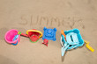 Colorful toys for childrens sandboxes against the sea and beach