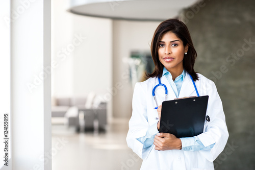 Fotografie, Obraz  Young Woman Hispanic Doctor Nurse in Medical Office