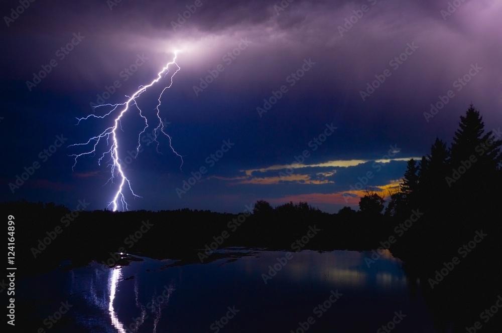 Lightning Storm Over A Lake
