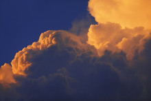 Yellow Clouds In Dark Sky