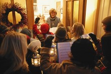 Carollers At The Front Door