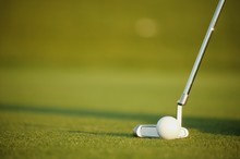 Closeup Of Putter And Ball