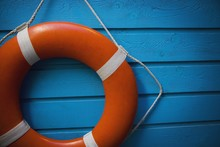 A Life Preserver Hanging On A Blue Wall