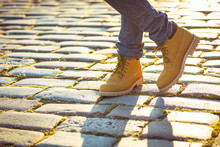Warm Yellow Boots. Walking In Autumn Leaves