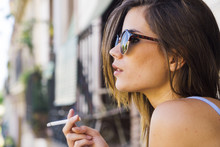 Beautiful Young Girl In Sunglasses Smoking Cigarette