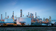 canvas print picture - Petrochemical plant (oil refinery) industry with blue sky