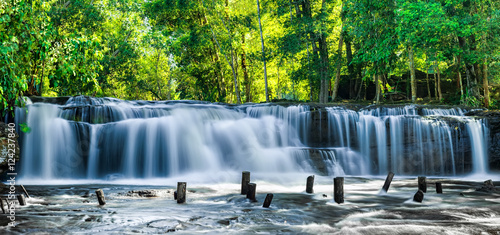 Wall Murals Waterfalls Tropical rainforest landscape with flowing blue water of Kulen waterfall in Cambodia
