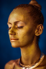 Portrait of golden woman's face