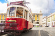 Famous old red tram on street of Lisbon/Lisboa.Plaza de comercio