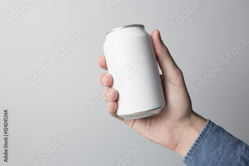 Photo  Blank Can in hand on white background, ready to replace your design