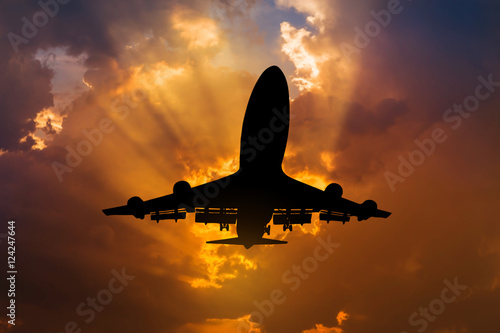 Fotografering  Silhouette airplane flying take off from runway  on sunset