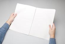 Blank Newspaper In Hand Mock-up