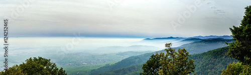 Fotobehang Wit Beautiful mountains landscape from the top of the hill with fog