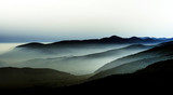 Beautiful mountains landscape from the top of the hill with fog - 124252822