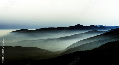 Foto op Aluminium Heuvel Beautiful mountains landscape from the top of the hill with fog