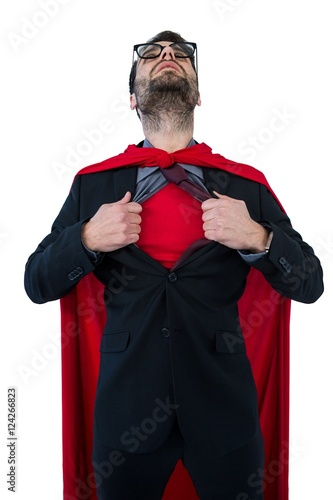 Fotografie, Obraz  Businessman pretending to be a super hero