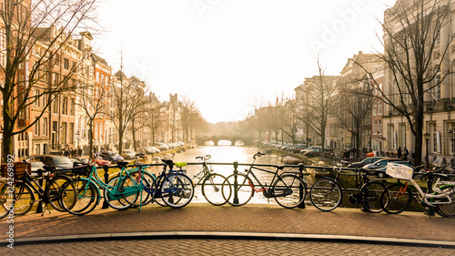 Amsterdam canal bridge with bikes #124269892
