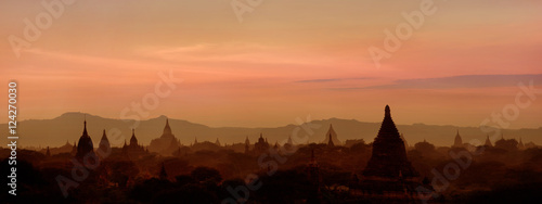 Garden Poster Brown Amazing sunset over ancient architecture of old Buddhist Temples at Bagan Kingdom, Myanmar (Burma). Two images panorama