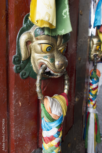 Fotobehang Stof An ornate doorknob in animal likeness with colourful fabric tied to it;Lhasa xizang china