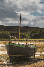A Boat Sitting On The Shore At Low Tide;Applecross Peninsula Highlands Scotland