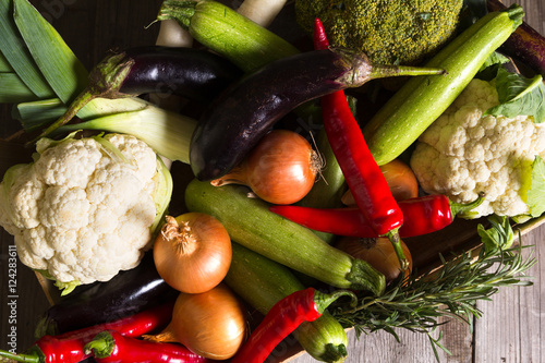 Fotobehang Different kind of local vegitables on the wooden rustic table. Organic food concept