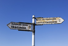 Road Sign In English And Gaelic Pointing To Castletownshend And Tragumna;County Cork Ireland
