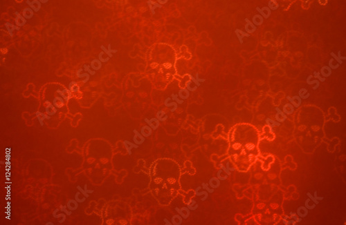 De-focused red bloody luminous grunge skulls & bones on the dark - 124284802