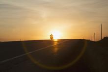 Man Riding A Motorcycle At Sunset On Alberta Highway Near Edmonton; Alberta, Canada
