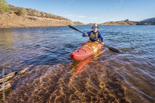 Fotografie, Obraz  paddling  kayak on mountain lake