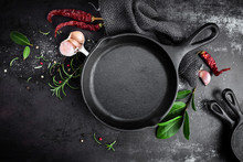 Cast Iron Pan And Spices On Bl...