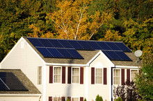 Solar Panel Installed On The House Roof With Autumn Trees
